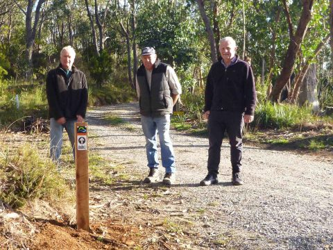 Joe Stellmann, a local landholder, with John Potter, from the Friends of the Heysen Trail, and helper Bill Gehling having installed the first Adelaide 100 post.