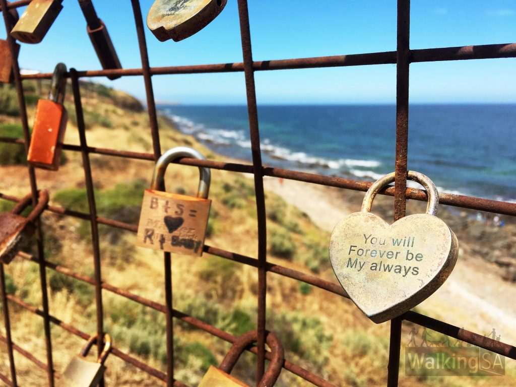 A Paris-style love-lock fence on a viewing platform in Marino Rocks