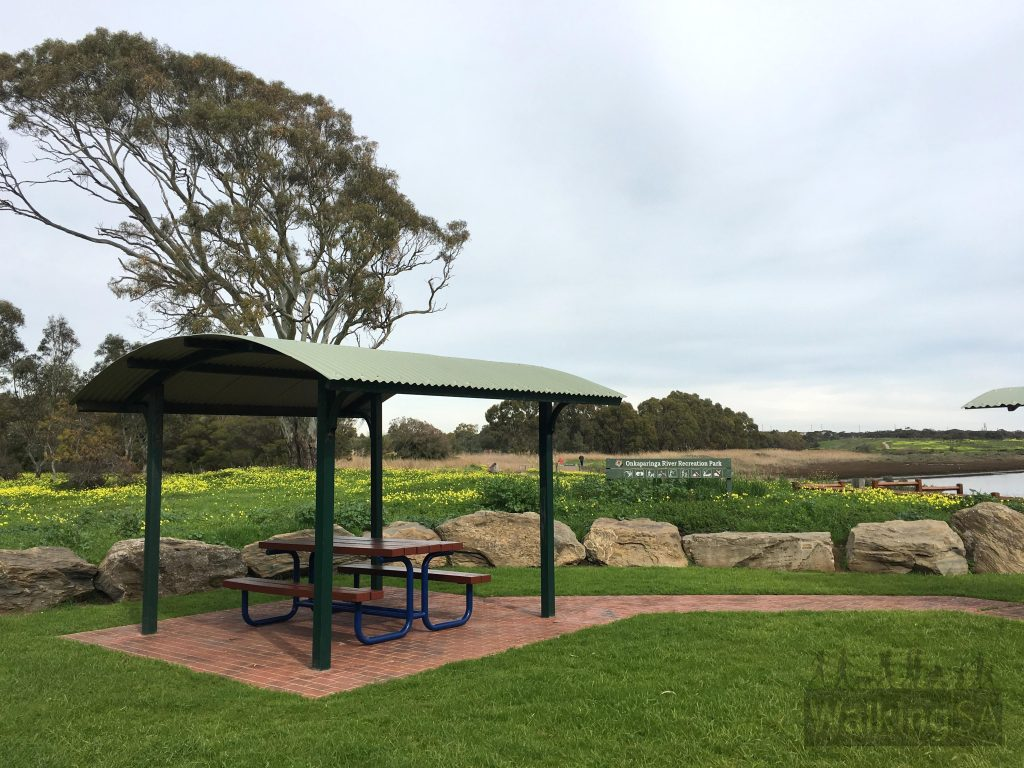 Picnic shelters and bbqs are the trailhead of the Wetlands Loop Trail