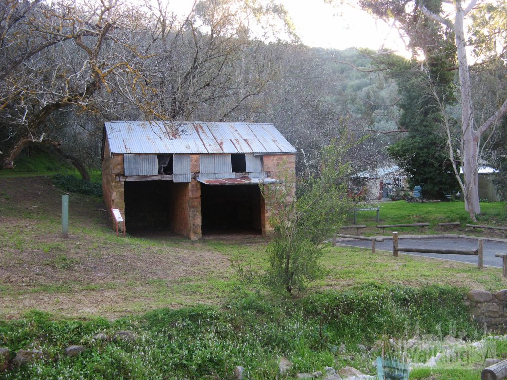 Old coachhouse in carpark