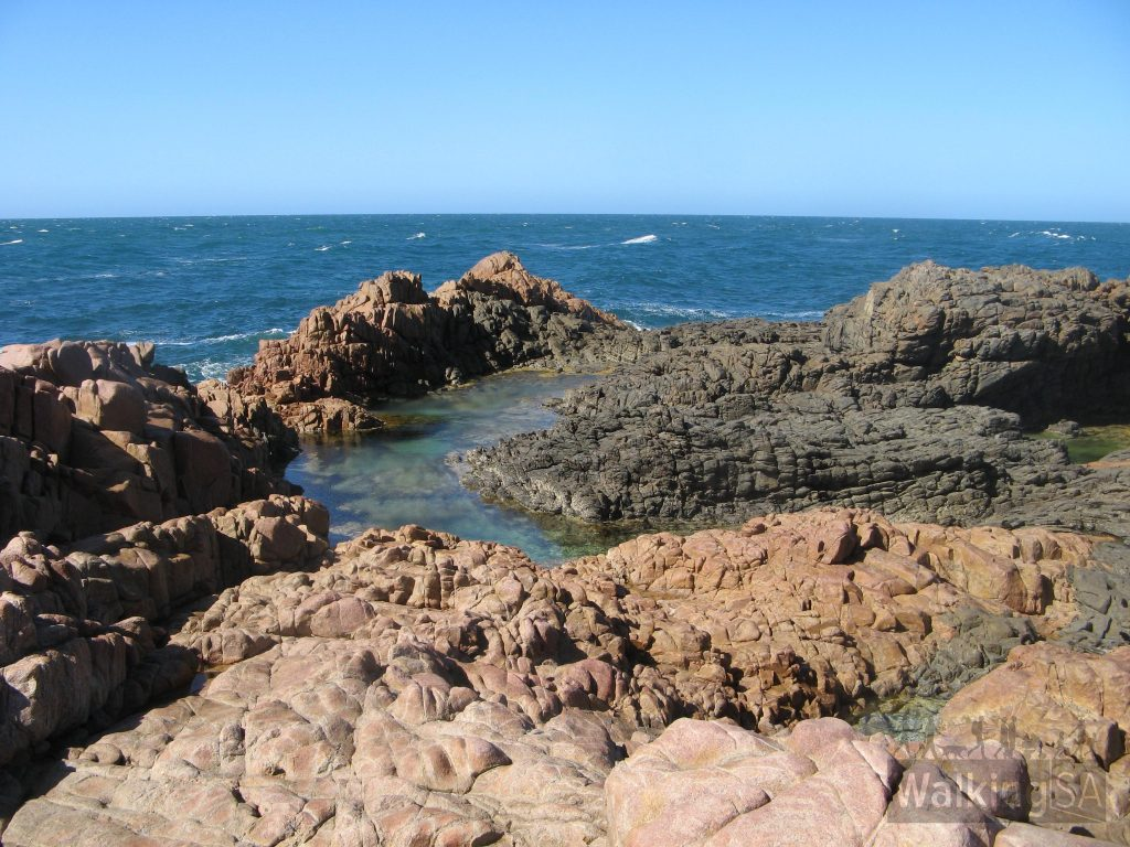 Walking past rock pools across rocky headlands