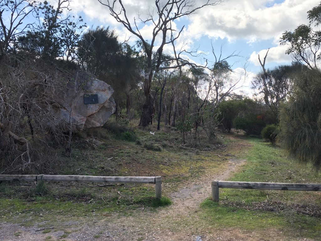 The Scenic Bushwalk, the hike that goes around the summit of Mt Barker, starts beside this boulder in the carpark