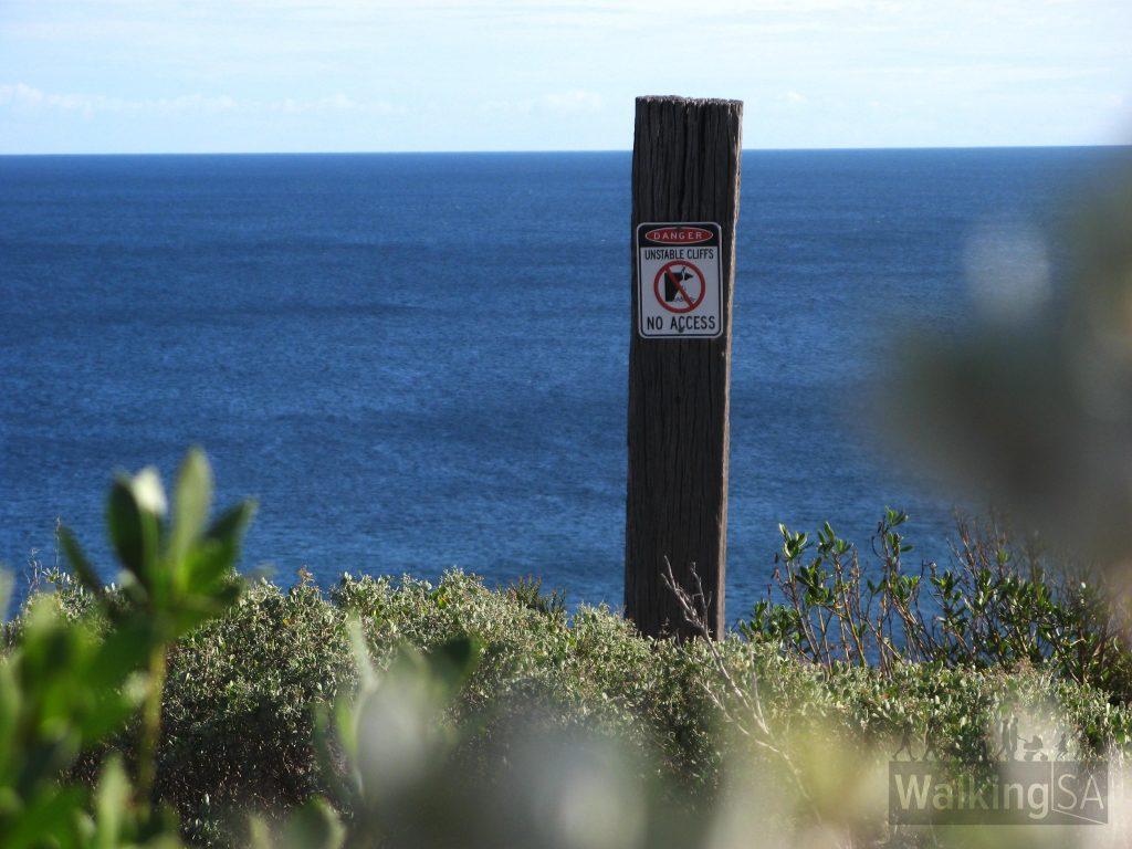 Be careful of steep cliffs beyond the trail fence
