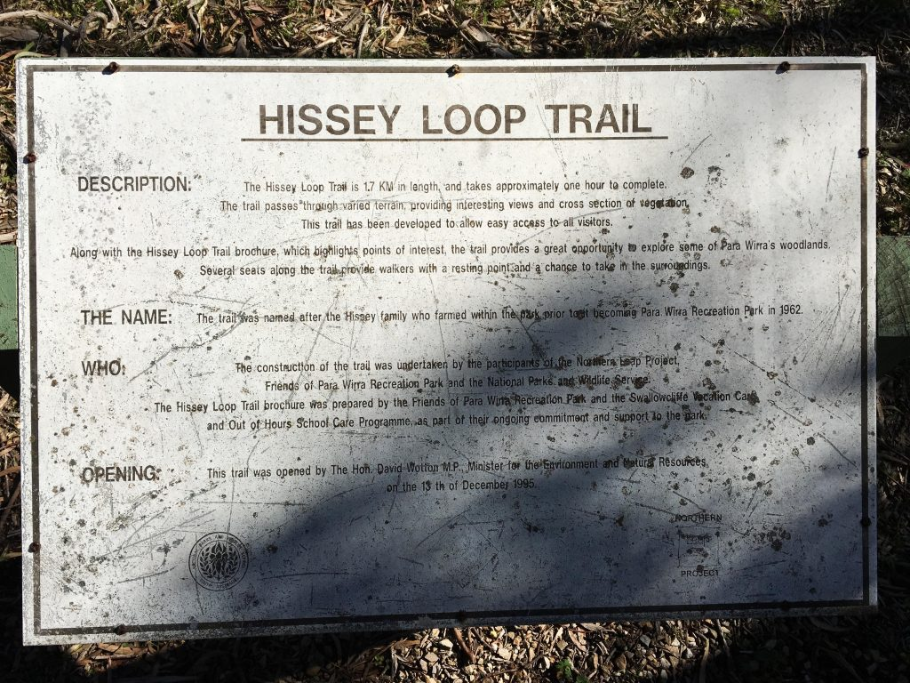 Old trailhead signage near the Park Office, on the Hissey Loop Trail