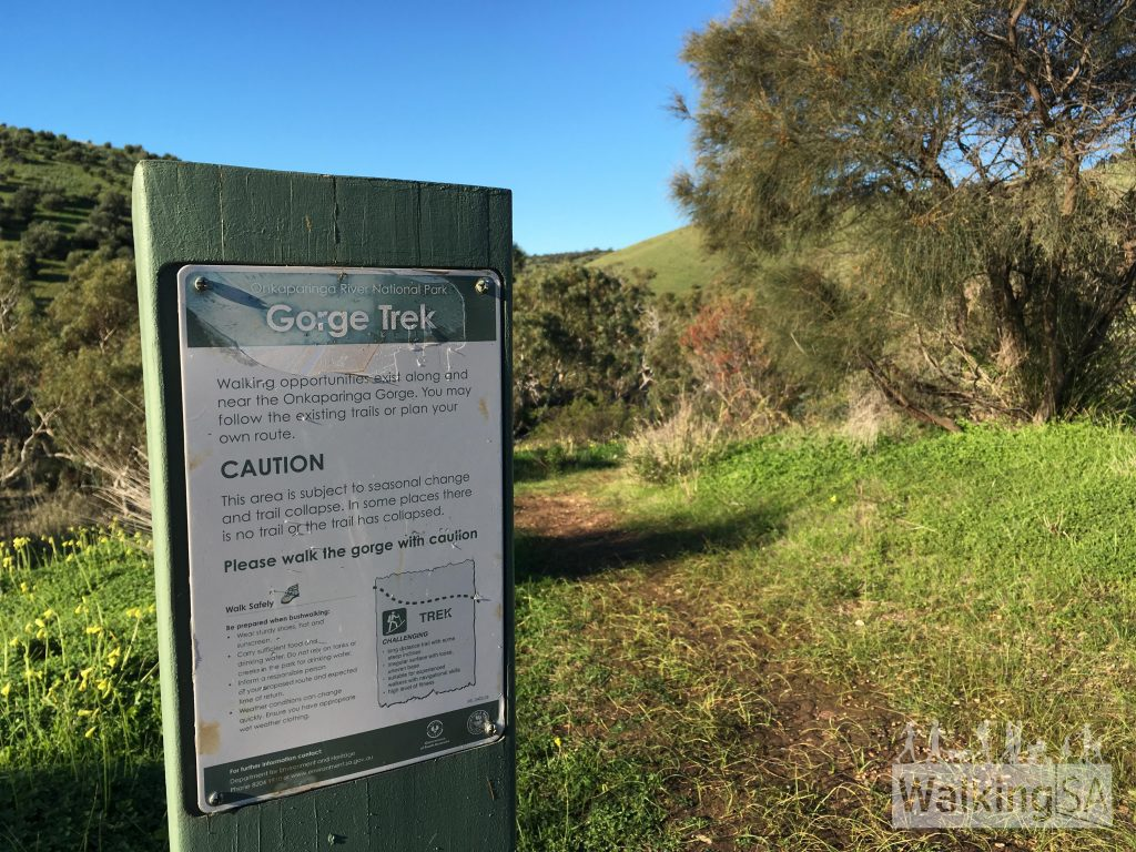 Warning about trail conditions along the Onkaparinga River. The trail for the Old Noarlunga Hike here is a relatively easy narrow trail, with one steep rock clamber