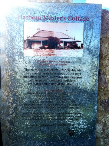 Interpretive sign on the ruins of the Harbour Master's cottage. Read in part: "