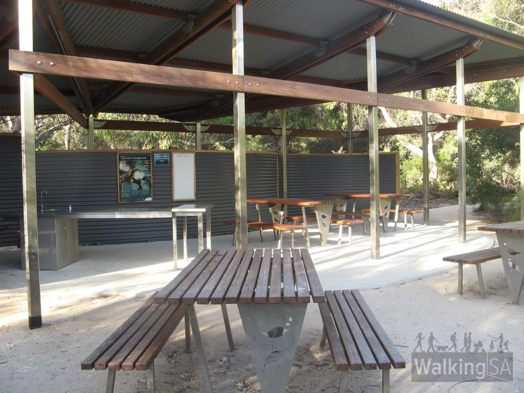 Kitchen and dining shelter at Cup Gum Campsite. At each of these shelters there are 4 park benches, a cooking and dishes area, water tanks, filtered water taps and a noticeboard