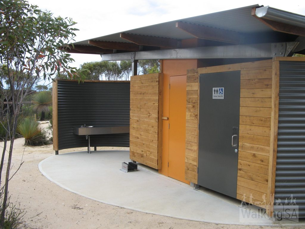 The bathroom facilties consist of two toilets, one inside a wheelchair accessible size room. There are two wash basins, one outside as seen here, and the other inside the larger toilet room