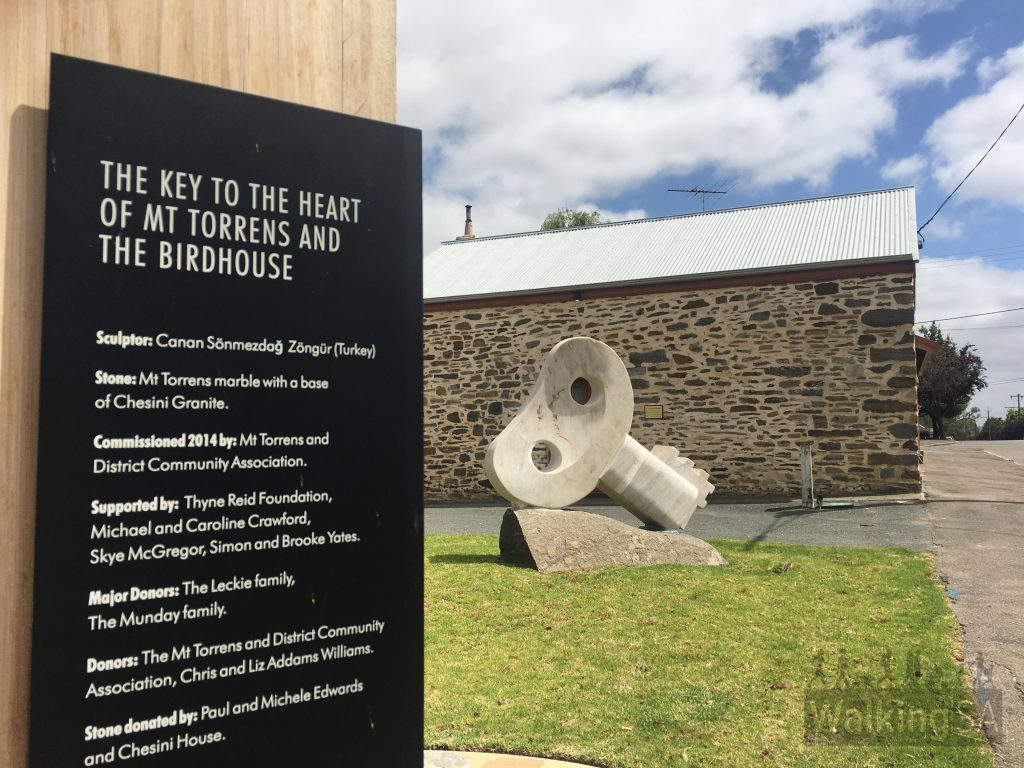 """This sculpture, 'The Key to the Heart of Mt Torrens and the Birdhouse' is in the main street of Mt Torrens and forms part of the <a href=""""https://www.adelaidehillssculpture.com.au/sculpturetrail/"""">Adelaide Hill Sculpture Trail</a>."""