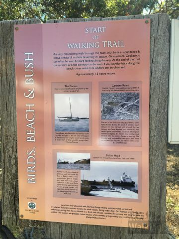 Trailhead sign which includes a short history of the cannery and gymsum works at Ballast head