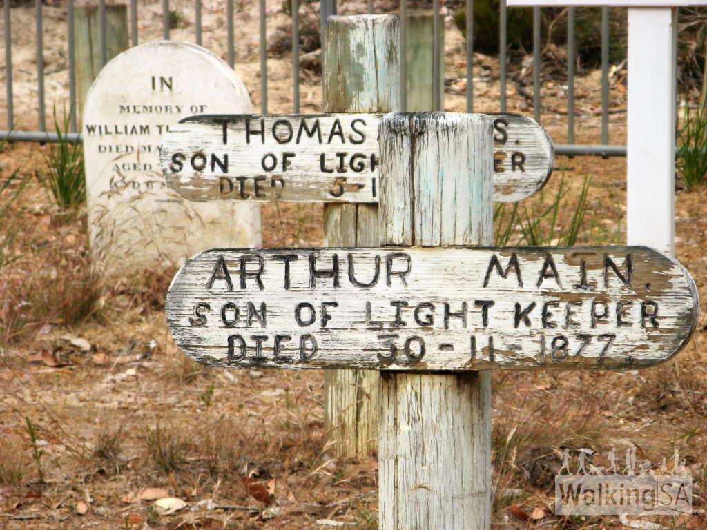Headstones at the Cape Borda cemetery on the Return Road Hike