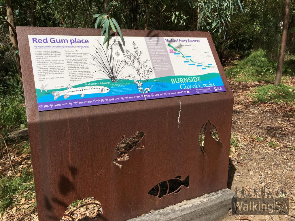 Interpretive signage in Michael Perry Botanic Reserve detailing information about the Kaurna people, the environment and the former exotic garden