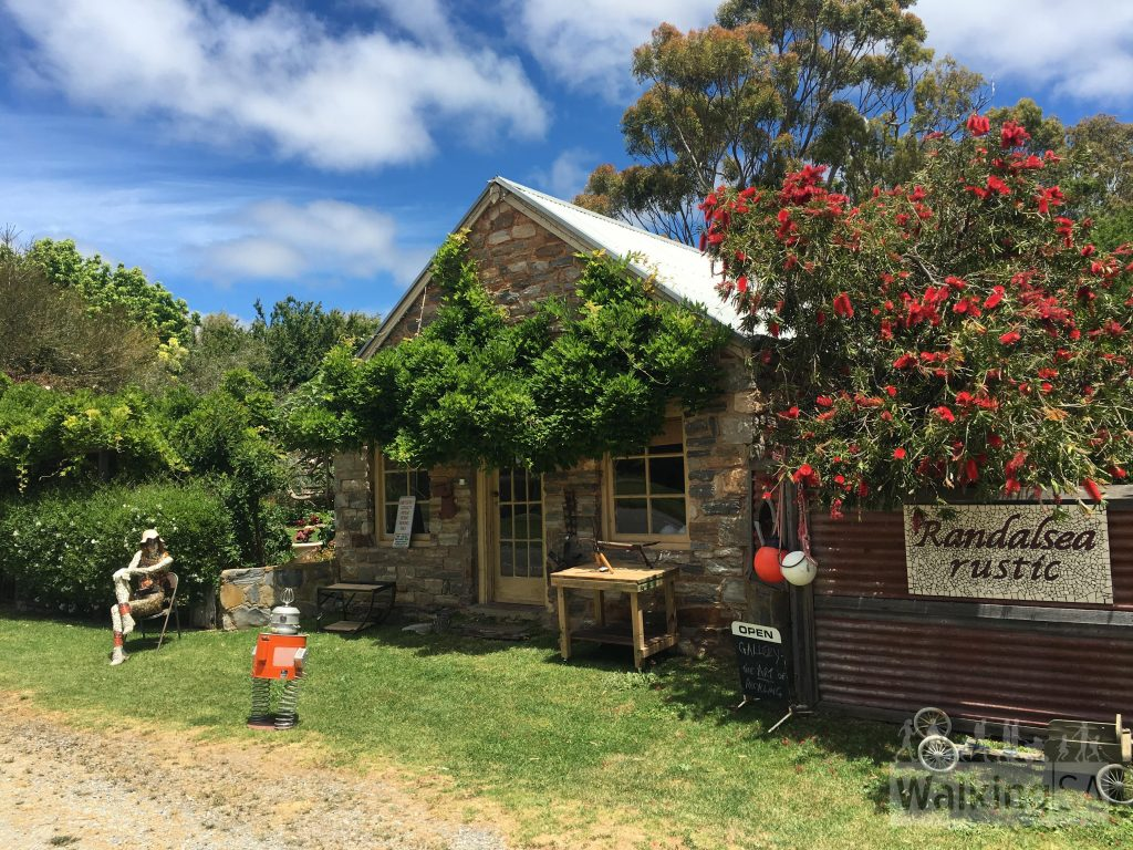 Point of Interest #3: Randalsea Rustic. Built in the 1850s, the original purpose of this rectangular building is unclear, although it was later used by a wheelwright and later to store bagged wattlebark