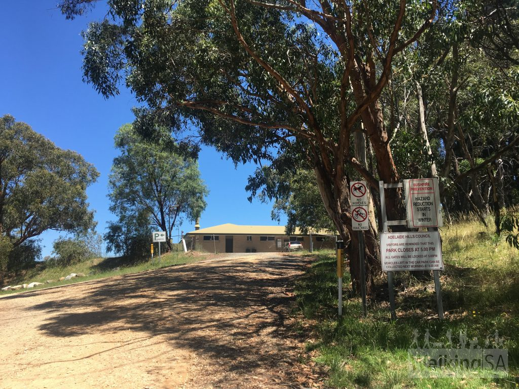 The carpark at Lobethal Bushland Park is open from 8am to 5pm. Horses, dogs and trail bikes are not permitted. There are toilets in this building, which is between the carpark (to the left) and the picnic area (to the right)