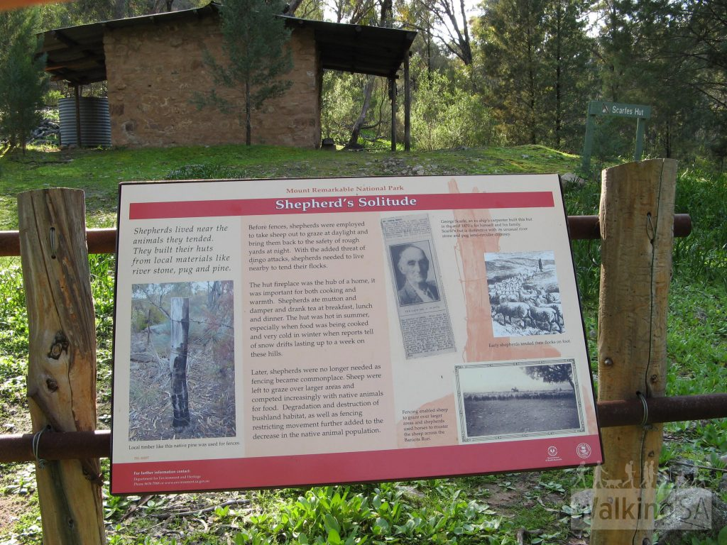 Interpretive sign about Scarfes Hut, an old shepherds hut