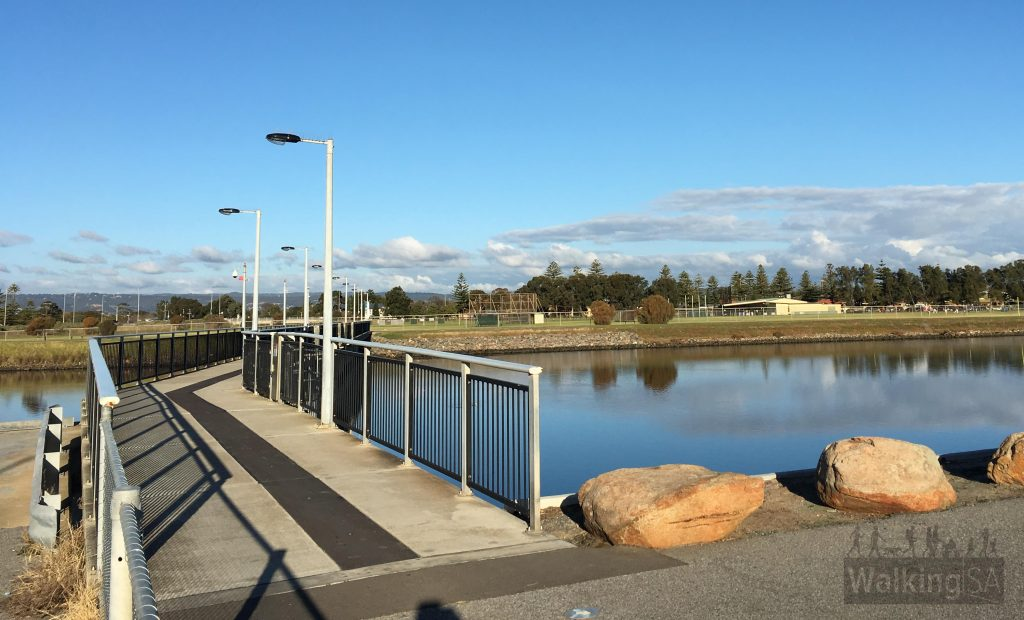 The best turn-around point to cross sides of the Patawalonga Lake is this footbridge near the skate park