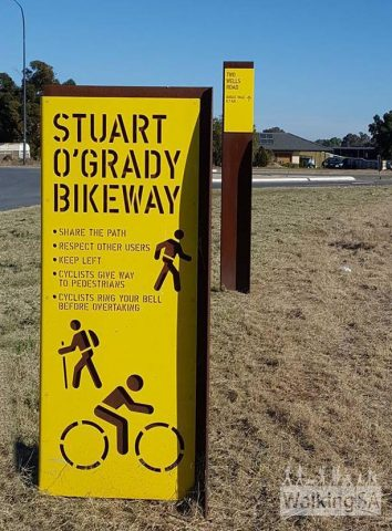 Trailhead sign at the northern end of the Stuart O'Grady Bikeway. The trail is a shared use trail for cyclists and walkers