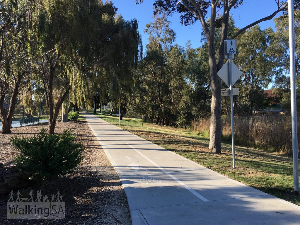 The Grange Lakes Shared Use Path is 2.5m wide path, providing an safe all-weather an accessible off-road route for a variety of users including bicycle riders, young school children, parents with prams, grandparents and the mobility impaired. The path includes public lighting.