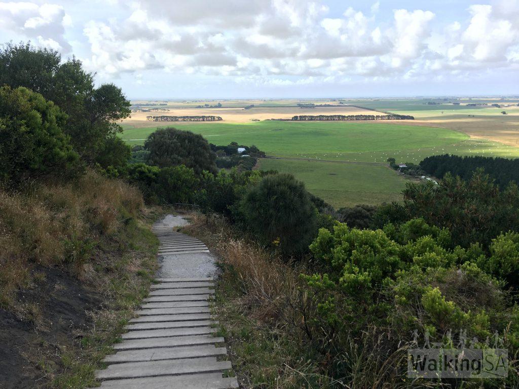 View down the limestone steps across farmland