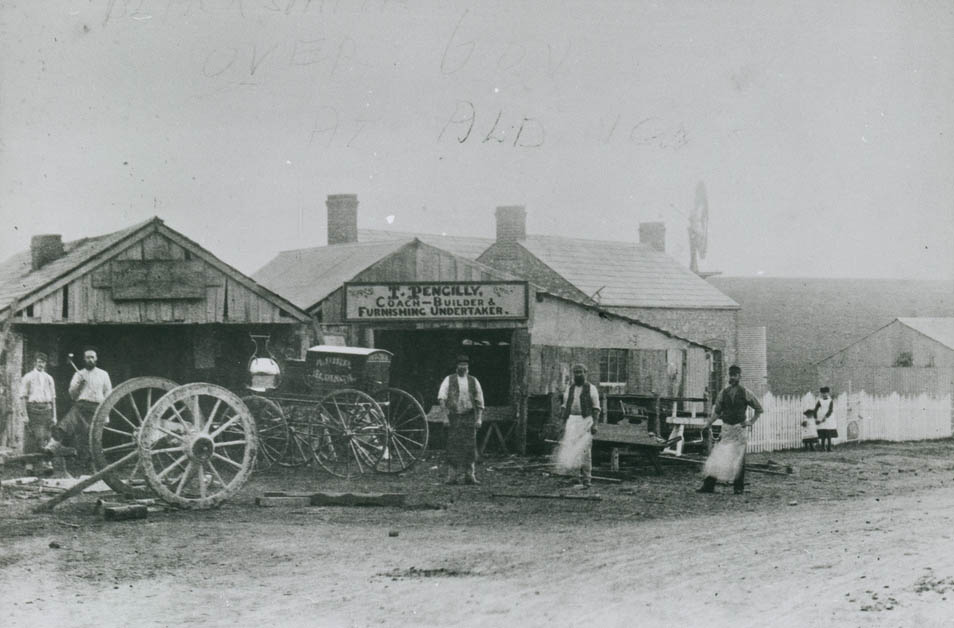 """Aldinga Blacksmith - Smithy and the premises of T. Pengilly, Coach-Builder and Furnishing Undertaker with cottage. Approximately 1890.<a href=""""https://collections.slsa.sa.gov.au/resource/B+21699"""">State Library of South Australia B21699</a>"""