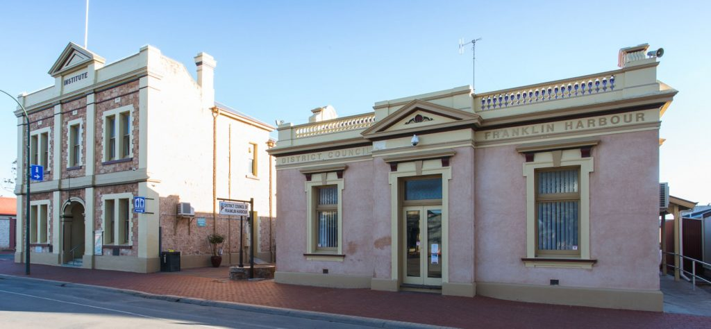 District Council of Franklin Harbour Council Chambers. In 1912 this was built for and used as a National Bank (banking chamber, strong room, manager's office and residence), by 1928 the commercial Bank was using these premises, in 1941 CWA Rest Rooms occupied the building, in 1946 Goldsborough Mort & Co Ltd and 1963 Elders GM. In 1985 it was purchased by Council and used as Council Chambers.