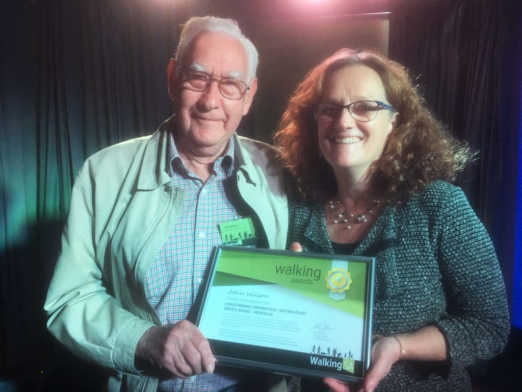 John Wilson accpeting his Walking Award for Long Standing Contribution / Distinctive Service Award - Individual for work with the Friends of the Heysen Trail and Warren Bonython Heysen Trail Foundation