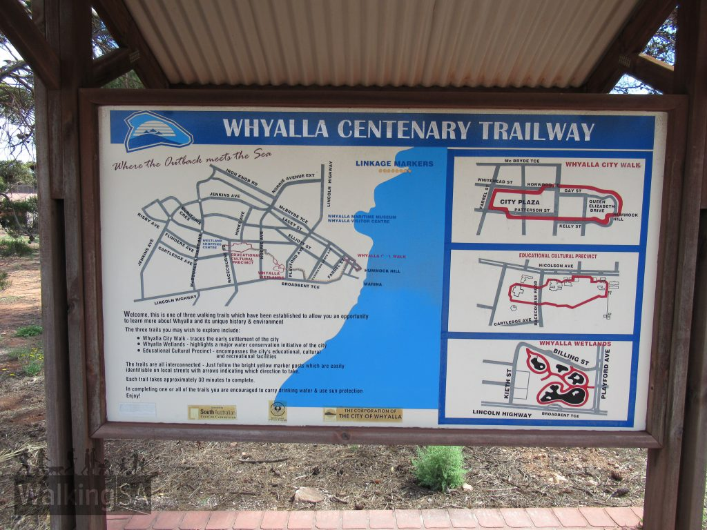 There is a trail info board showing the three Centenary Trailways Project trails