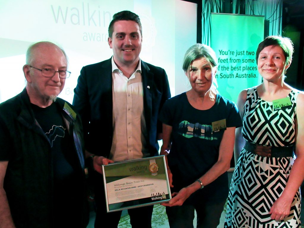 Chris Davies (L) and Zara Lupton (R) with Matt Cowdrey MP, Member for Colton and Tuesday Udell, Walking SA Chair. The Willunga Basin Trail Inc won a Walking Award: Special Recognition Award – Group Organisation for the Willunga Basin Trail development. The Willunga Basin Trail group has instigated and is now delivering a new trail that will encourage walking and connection to local stories.