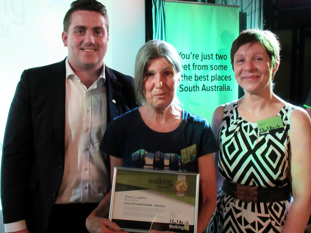 Zara Lupton (L) with Matt Cowdrey MP, Member for Colton and Tuesday Udell, Walking SA Chair. Zara won a Special Recognition Award – Individual for her work with the Willunga Basin Trail.