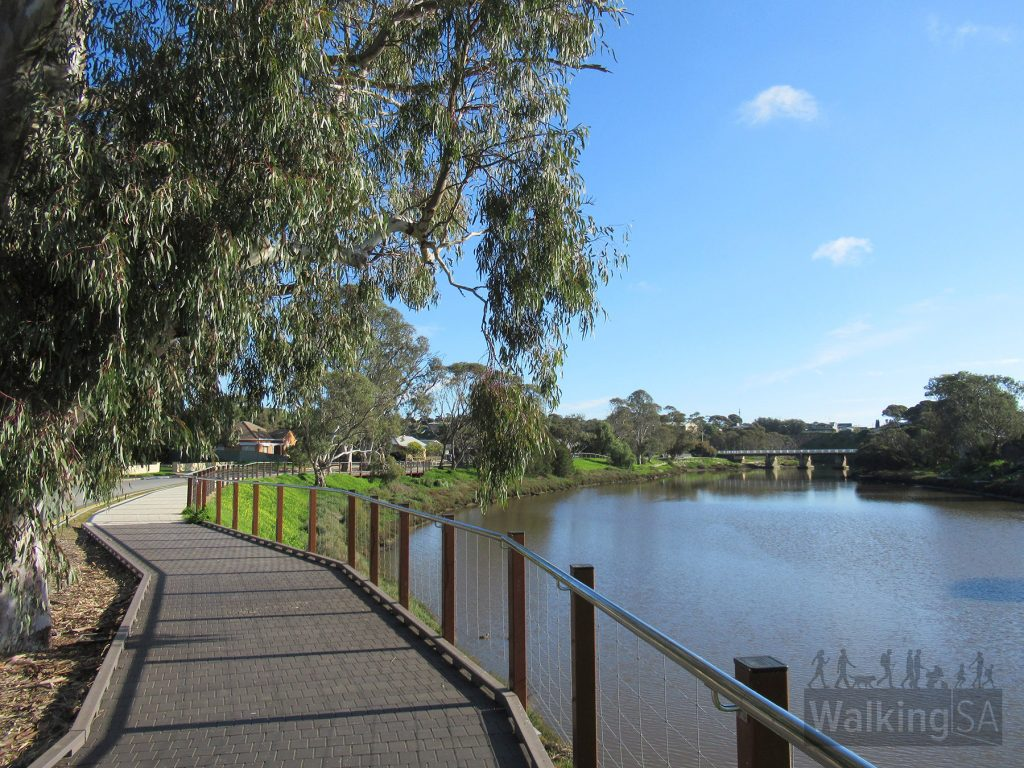 Walking along the riverside path, beside Hall Crescent